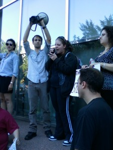 Adam Lansky holds the bullhorn while Andrea Ross reads the Occupy Wall Street manifesto to protesters.