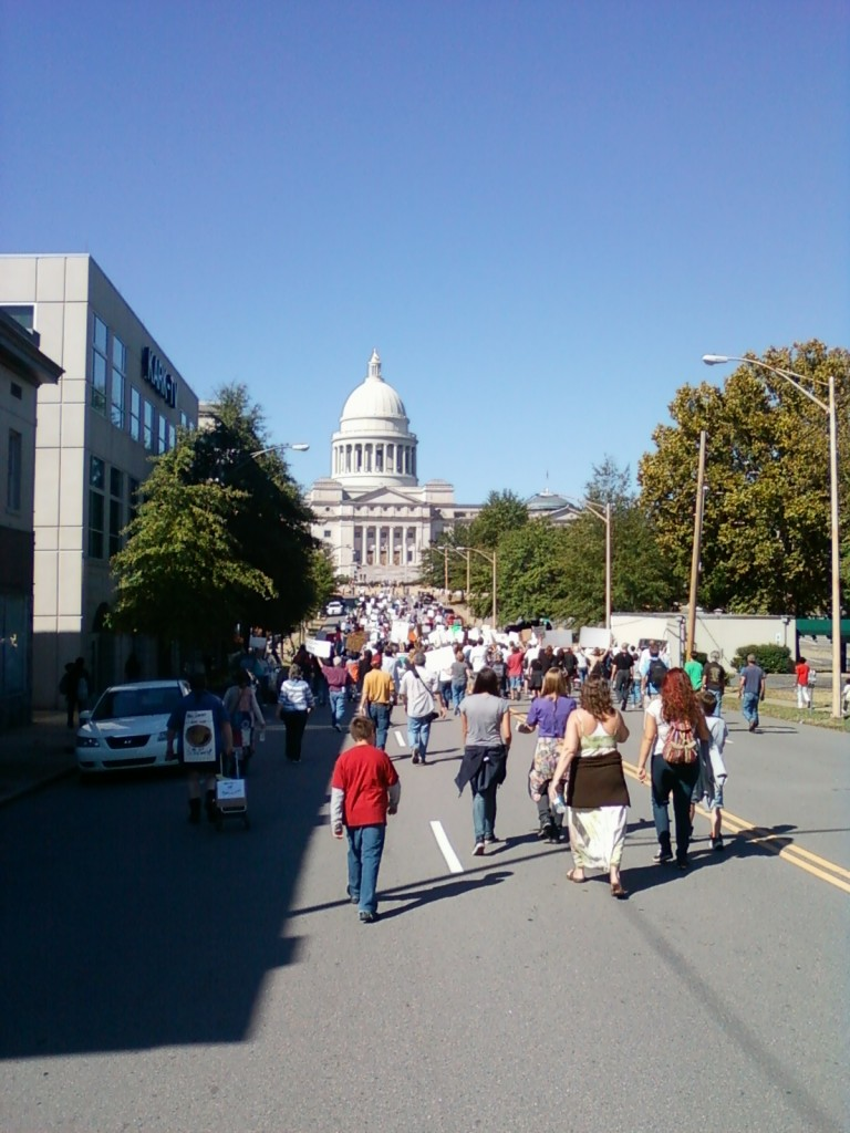 Protesters move in a wave toward the State Capitol. (photo by Sitton)