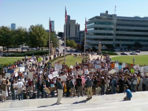 Protesters gather near the steps the State Capitol, but stay off the grounds. (photo by Sitton)