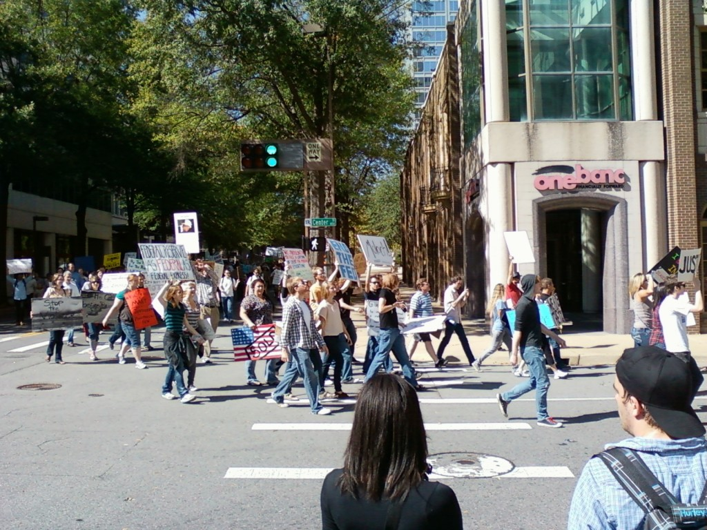 Protesters return along the same route down Center Street towards the River Market. (photo by Sitton)