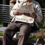 256px-Reading_newspaper