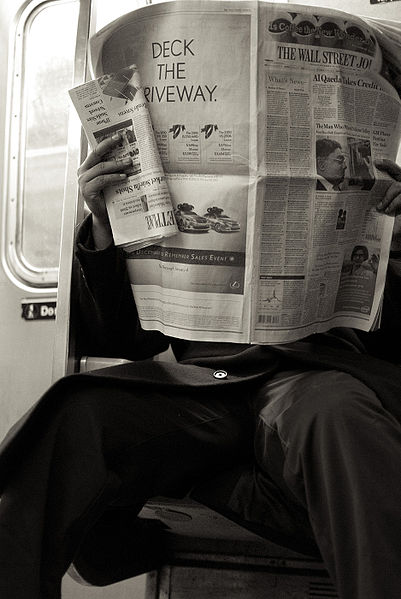401px-2009_reading_newspaper_NYC_4328271821