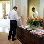President Barack Obama reads the newspaper in the White House's Outer Oval Office in this March 2009 file photo by Maison Blanche. Courtesy of Wikimedia Commons